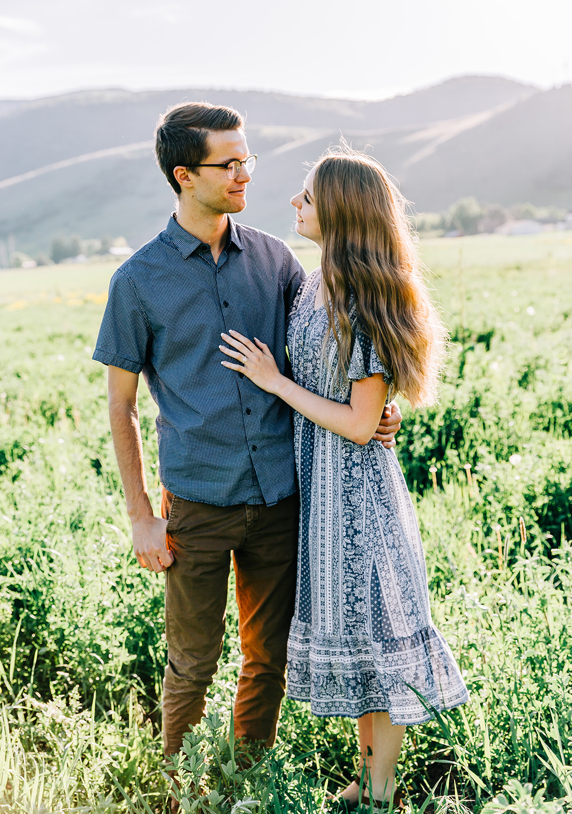 Professional engagement photographer couples session on a mountain mantua utah flower fields engagements outfit inspo by couples photographer bella alder photography #bellaalderphoto #engagements #ldscouple #mountainengagements #savethedatephoto #weddingplanning #utahengagementphotographer #utahengagements #mantuautah #loganutahengagementphotographer #engagementpictures #engagementoutfits #outfitinspo