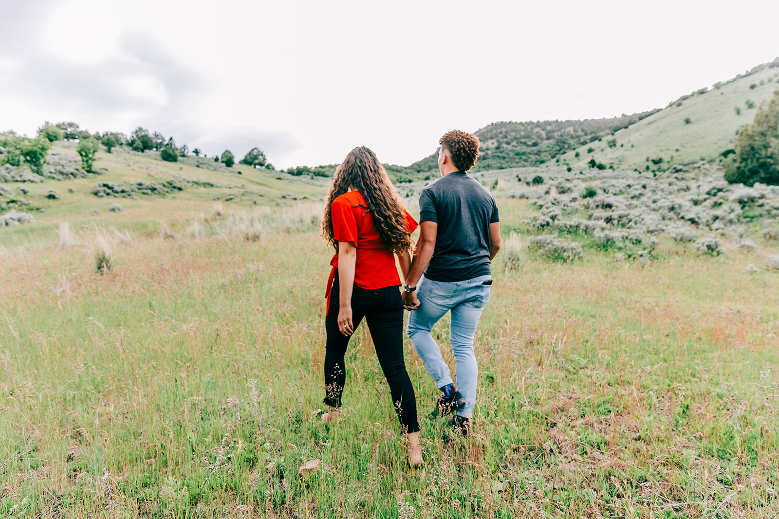 Couple walking away holding hands engagement photos inspiration outfit inspo professional engagement pictures by Bella Alder Photography northern utah engagement photographer #bellaalderphoto #engagements #mountainengagements #utahengagements #weddingplanning #engagementphotographer #utahengagementphotographer #couplesphotography #engagementsession #utahcouples #paradiseutah #cachevalleyutah
