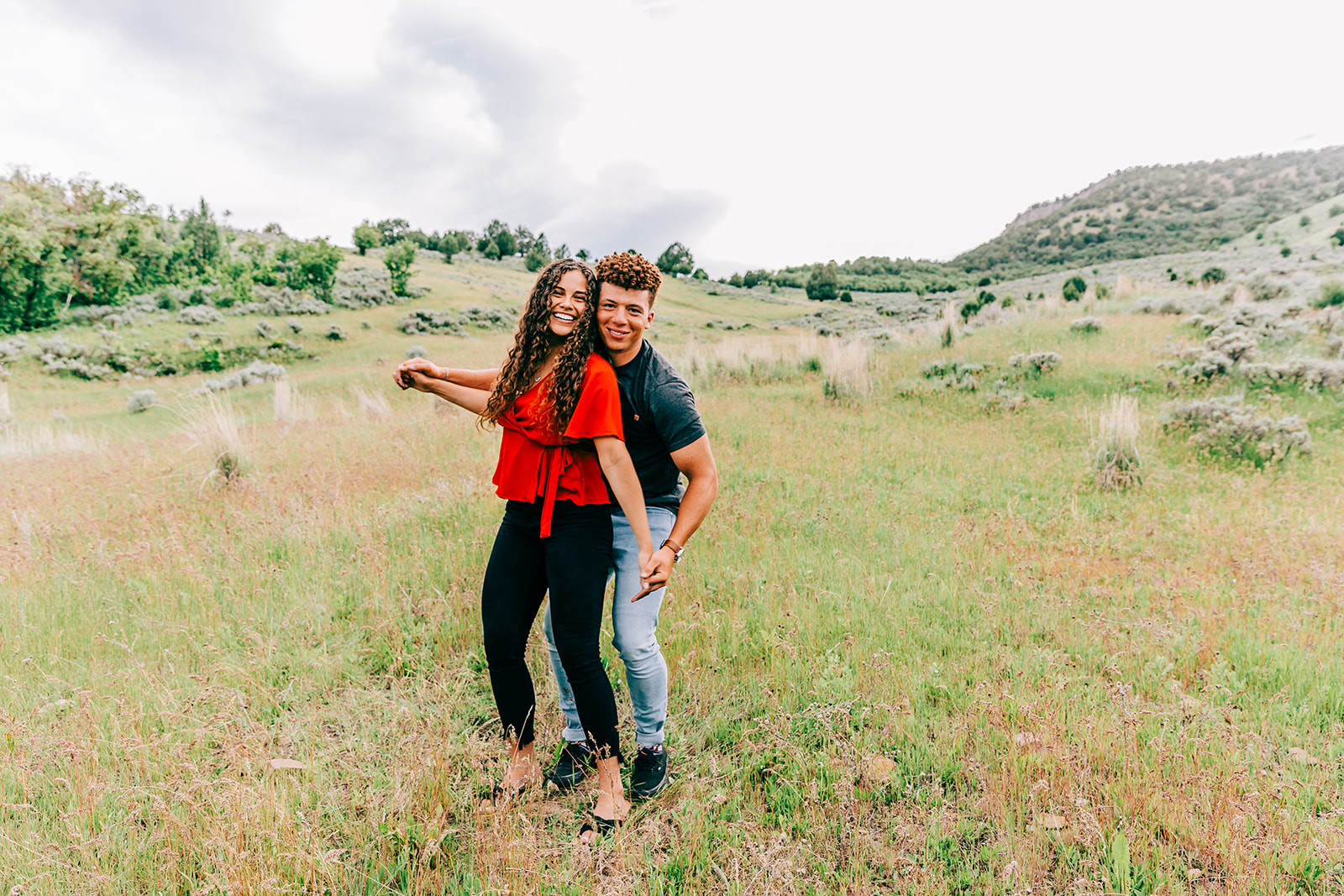 Couples session dancing in a field of wildflowers on top of a mountain in Paradise, Utah northern utah engagement photographer Bella Alder Photography professional couples session #bellaalderphoto #engagements #mountainengagements #utahengagements #weddingplanning #engagementphotographer #utahengagementphotographer #couplesphotography #engagementsession #utahcouples #paradiseutah #cachevalleyutah