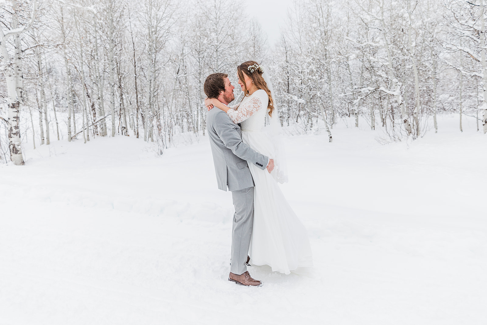lifting up the bride romantic couple pose for weddings sweet couple interesting background tony's grove wedding picture location ideas winter wedding inspiration cache valley couple sweet moment captured winter wedding goals wedding aesthetic #winterwedding #formals #tony'sgrove #cachevalley #snowcoveredtrees #bellaalderphotography #professionalphotographer #winterwonderland #couplegoals #weddingattire