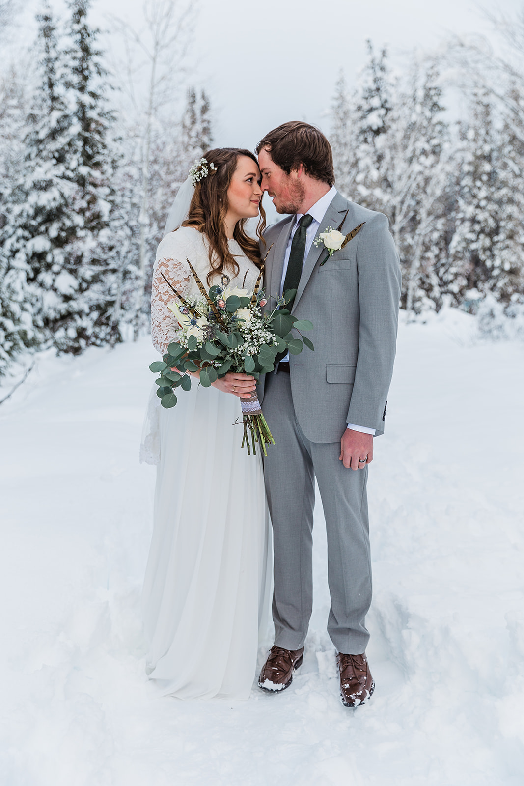 looking into each others eyes long sleeved lace wedding dress not full sleeves simple white boutonniere boutonniere inspiration minimal wedding colors winter formals greenery in winter bouquet bella alder photography professional photographer #winterwedding #formals #tony'sgrove #cachevalley #snowcoveredtrees #bellaalderphotography #professionalphotographer #winterwonderland #couplegoals #weddingattire