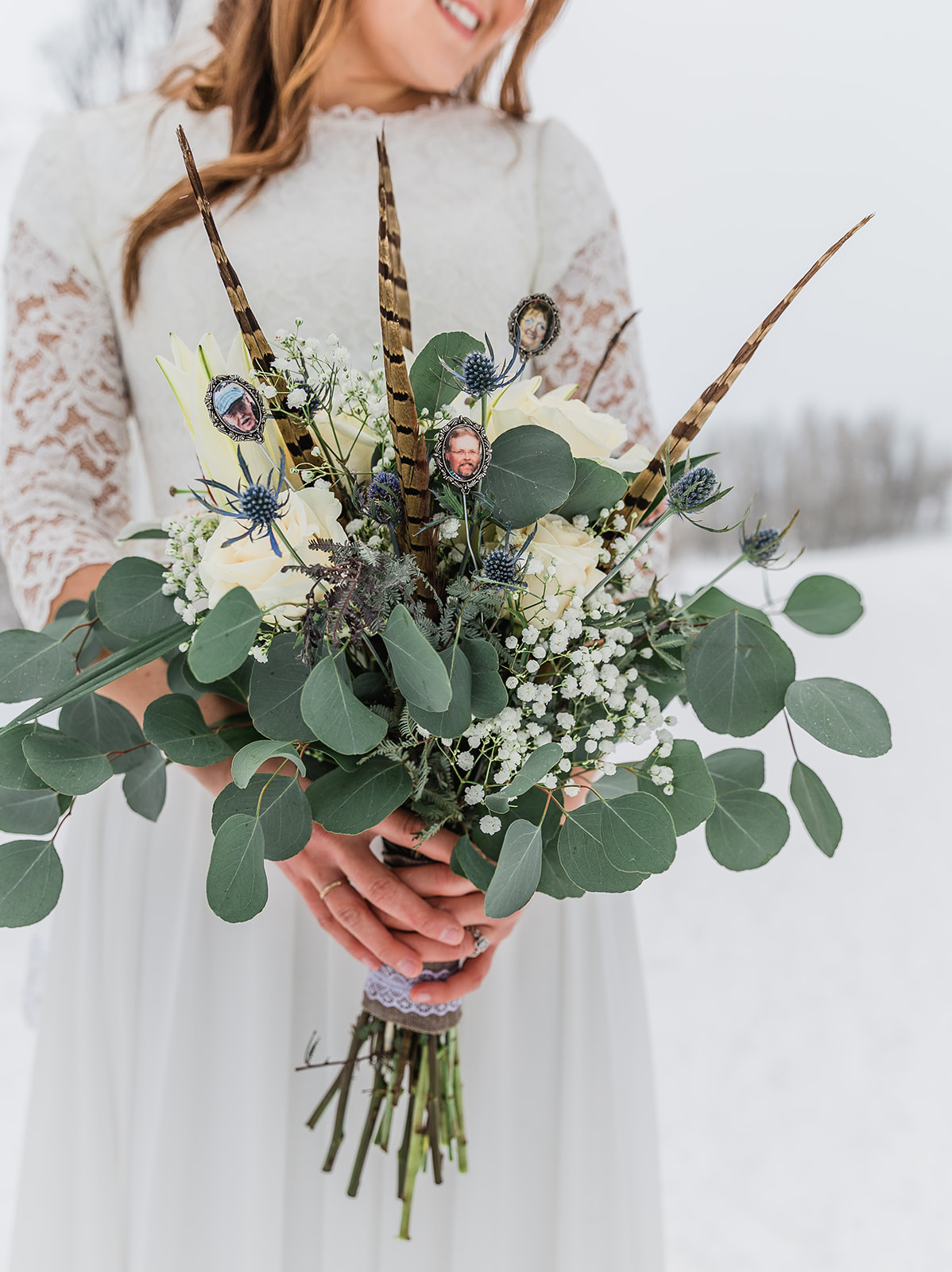 winter wedding bridals country inspired bouquet pheasant feather touches white flowers beautiful greenery elegant and simple winters day photo shoot formals of the bride bridal session wedding look inspiration aesthetic picture for the groom #winterwedding #formals #tony'sgrove #cachevalley #snowcoveredtrees #bellaalderphotography #professionalphotographer #winterwonderland #couplegoals #weddingattire