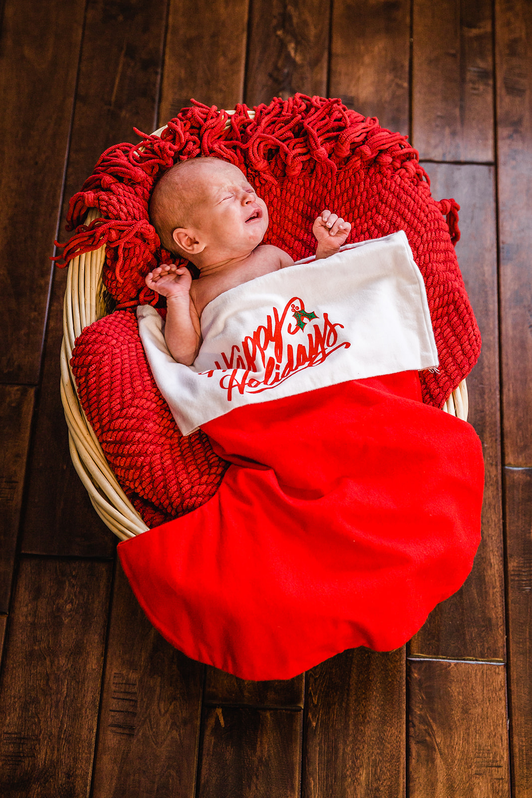 newborn stocking stuffer christmas themed newborn photo shoot #newborns christmas miracle baby on a red knit blanket newborn in a basket inspiration swaddled in a stocking sweet crying baby tis the season to have a baby precious new baby pictures holiday photo shoot inspiration baby boy #preston #idaho #littletyke #christmas #stockingstuffer #babyshoottheme #babyboy #preciousangle #christmasmiracle