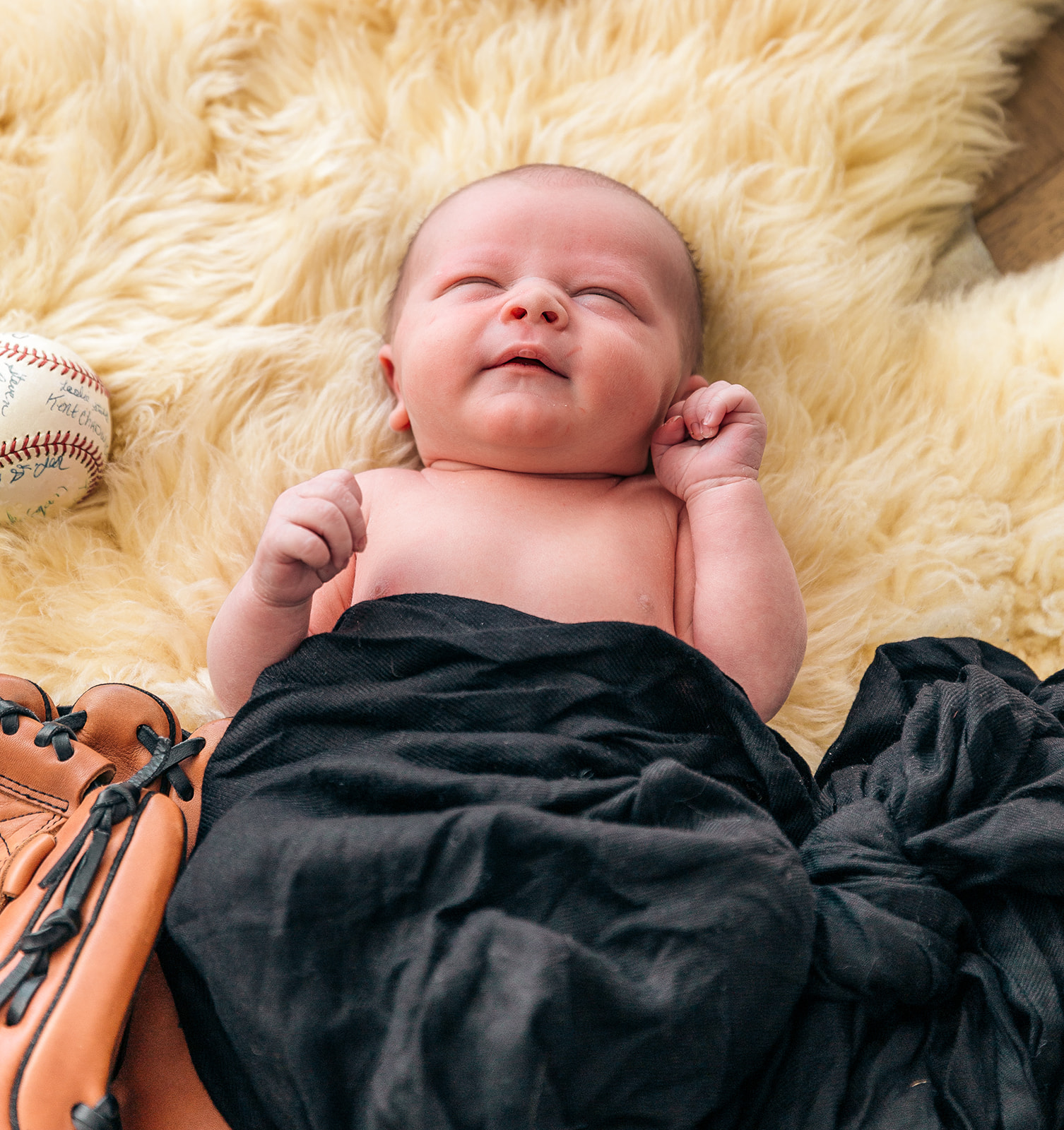 little boy with baseball props baseball glove sport little man newborn photo session newborn pose with baseball ball and glove little tyke boys are the best newborn baby pose inspiration ogden utah professional utah photographers bella alder photography inspiration #newbornsession #bundleofjoy #babyboy #babyboybeckham #littleangle #familygoals #ogden #utah #professionalphotographer #bellaalderphotography