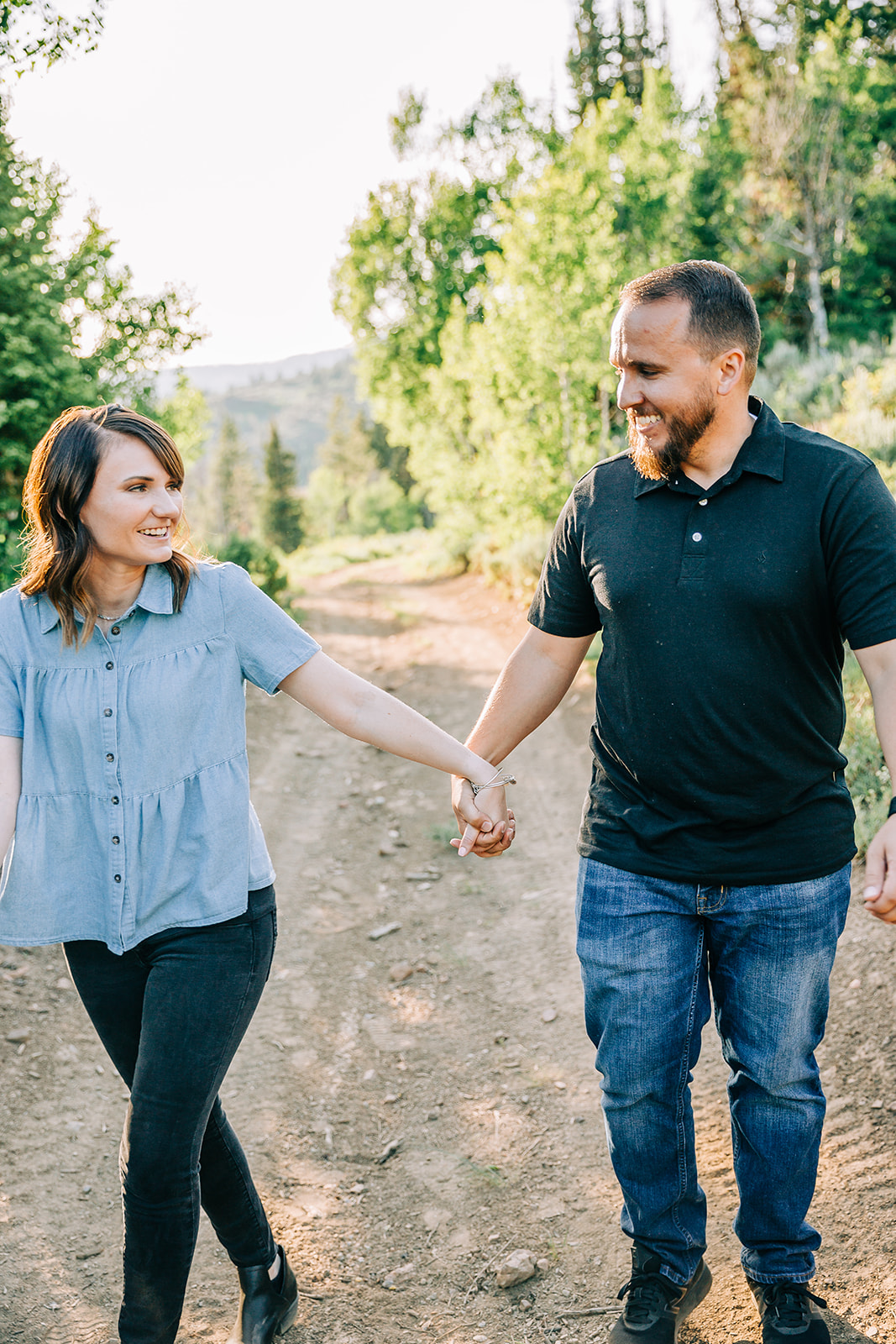 Couple holding hands during mountain engagement photo shoot in Cache Valley, Utah by professional engagement photographer Bella Alder Photography #bellaalderphoto #engagements #utahengagements #engagementphotographer #engagementphotography #loganutahengagementphotographer #utahengagements #utahengagementphotographer #mountains #mountainengagements #weddingplanning #utahwedding