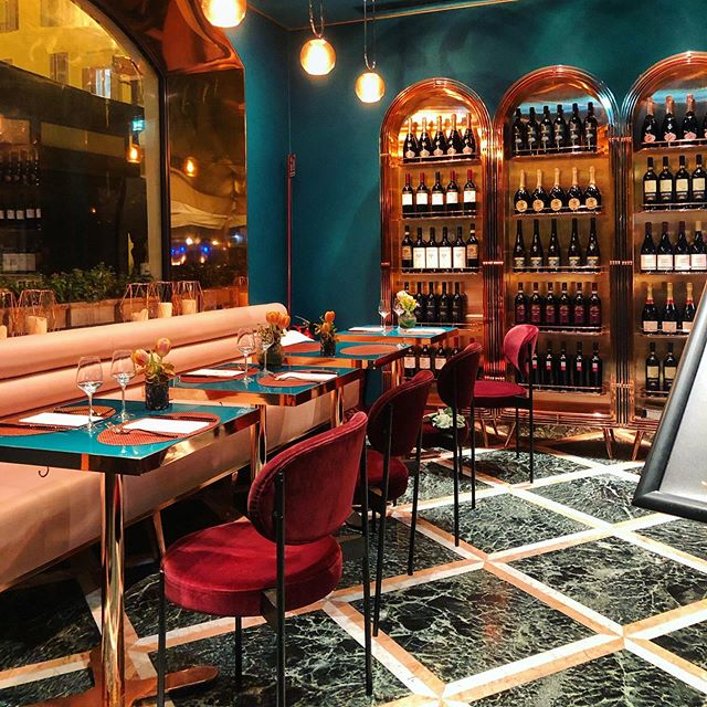I took pix of my favorite rooms while traveling because of my love of interior styling. We didn't eat at this restaurant, I just popped my head in and snapped. The rose gold wine shelves, velvet chairs and teal walls. Wow.