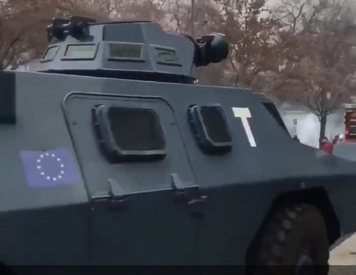 French law enforcement vehicles involved in riot control have EU flags