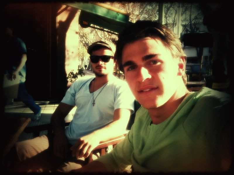 At an outdoor cafe, with the allstar team. (before my haircut)