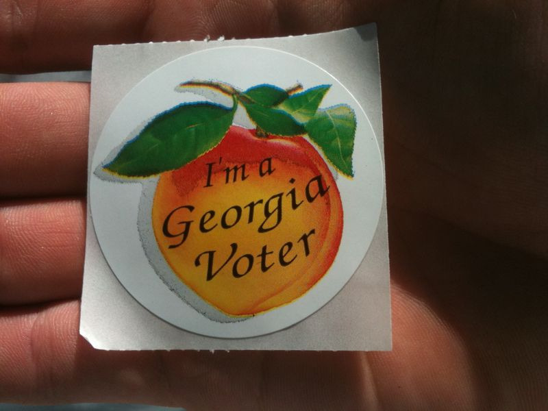 Someone drove my car and left the lights on all day, so now I'm stranded at the voting office with my peach sticker…