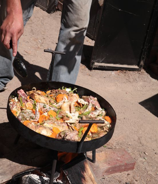 Yesterday, we invited Lalo, aka the Asado Maestro, to come over and make a specialty chicken dish for some people who were going to come to our house.   He started off building the fire underneath a large outdoor stove/pan. First, he threw in onions and butter (lots). Then peppers and carrots and many different spices, some I knew, some I didn't. Next he threw in the chicken. Then he poured in little white wine and tomato juice. Then he let it simmer for a couple of hours.  I'm not sure what word to use for it, it was amazing. It had such a rich flavor. I could probably eat it at least 5 times a week.         It reminded me of a book I read when I was little called  Stone Soup , it would always make me so hungry when I read it.