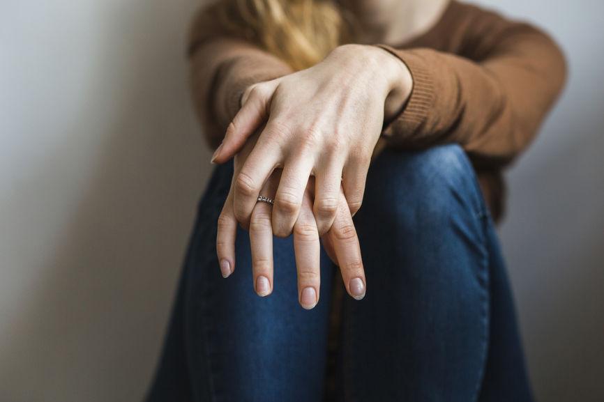 Integrative Medicine, Richmond, VA, an image of a woman sitting down holding her hands on across her legs.jpg