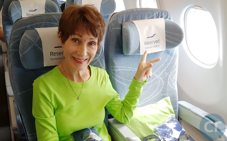 Rickee settles into her Economy Comfort seat on the Finnair A330