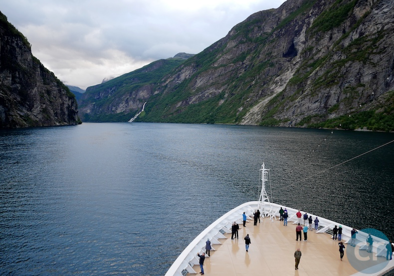 Guests gather on the bow for the sail into Geirangerfjord