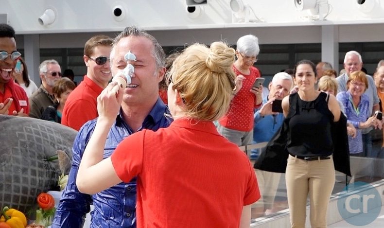 Aaron's nose is painted blue (Asst. Cruise Director, Courtney, can be seen readying herself for the plunge)