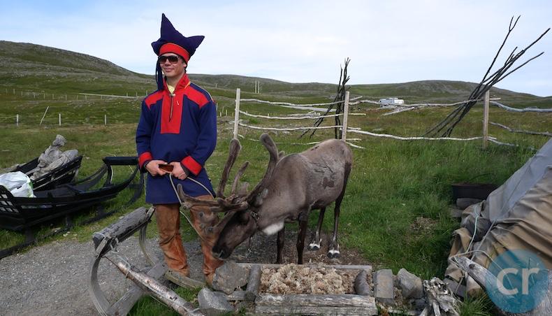 Sami man with reindeer