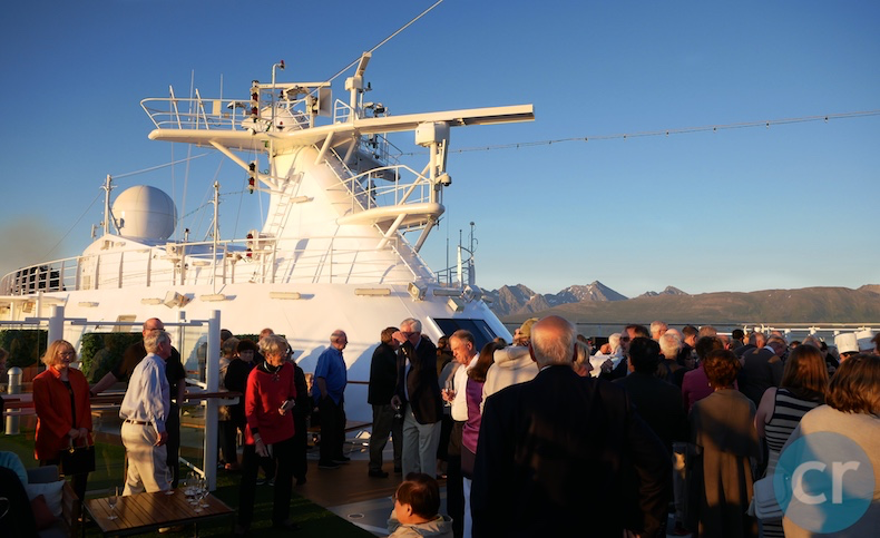 Guests gather on Deck 9 Forward for Midnight Sun Celebration