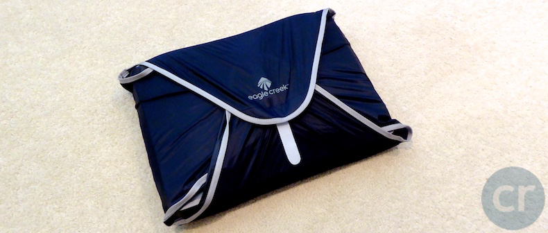 Large garment folder packed with two pair of slacks and six shirts
