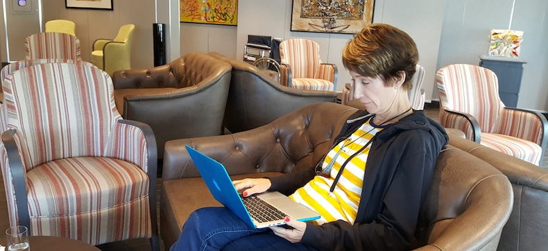 Rickee adds her thoughts and proofreads the blog in the Arts Cafe on Silversea Silver Muse