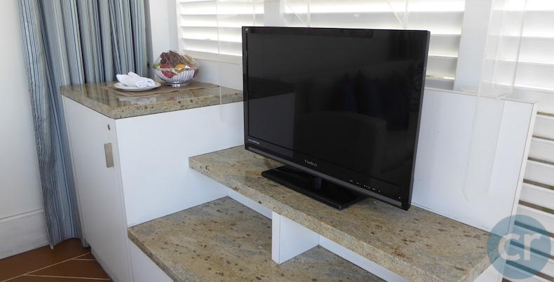 Flat-screen TV and fruit basket