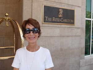 Rickee stops for a photo in front of Ritz-Carlton