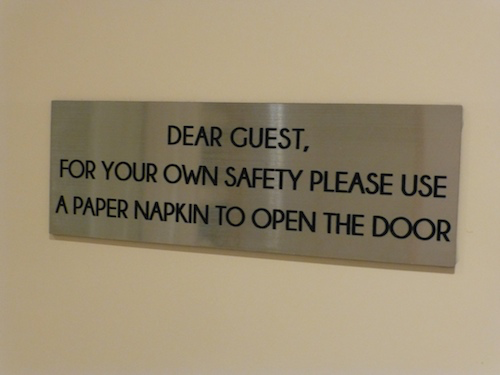 Silversea reminds guests to use a tissue (which are provided) to open the door