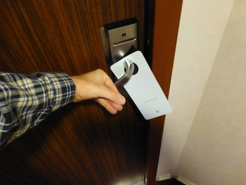 Use the back of your hand to open door handles
