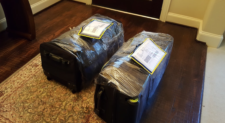 We wrap our luggage in plastic wrap (not required) and attach the labels for shipping