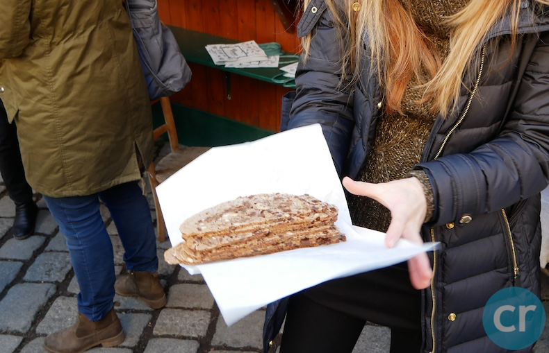 Barbara hands out slices of fruitcake