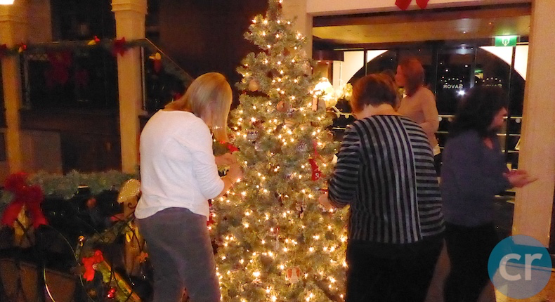 ms Savor guests decorating tree