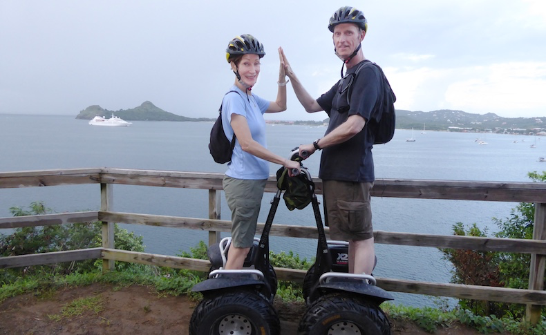 A high-five on our Segways with Star Pride in the background