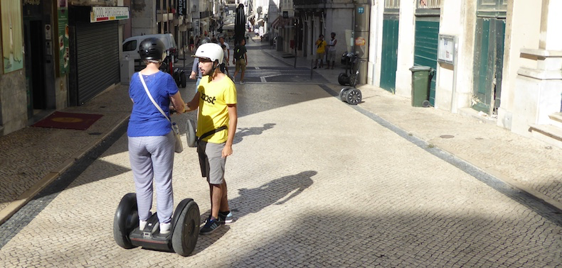 Ruben explains the safe operation of the Segway to Barbara, one of the tour participants