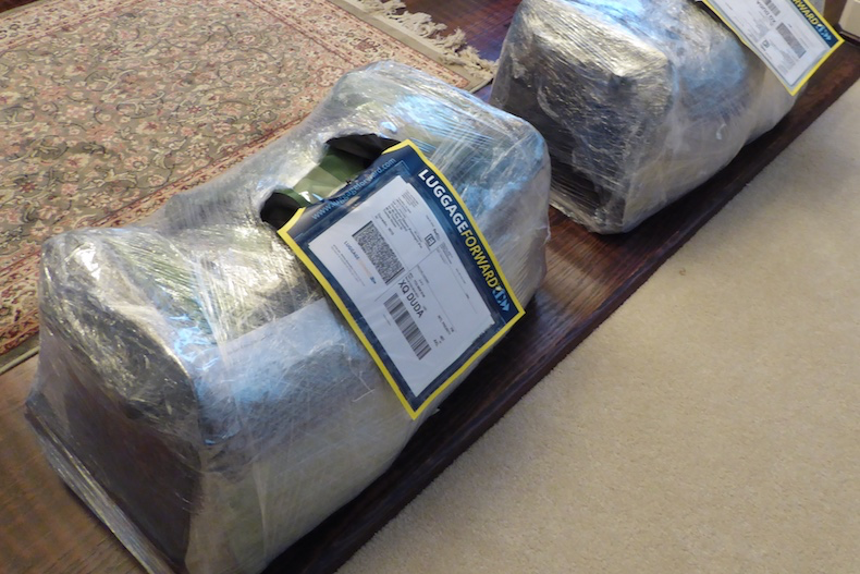 Our two large bags are wrapped in plastic with Luggage Forward labels attached