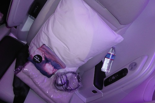 Spaceseat amenity kit, headphones, large pillow and blanket