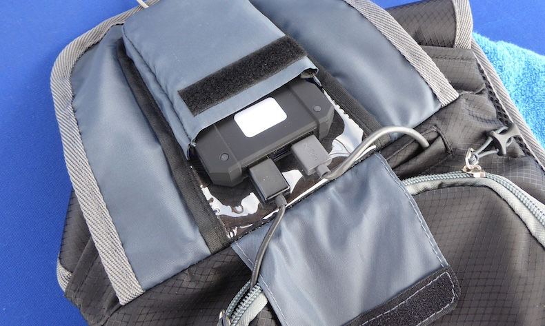 Battery pack slips into a pocket on the top flap of the Solar Sack