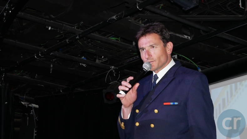 The Captain greets guests in the theater