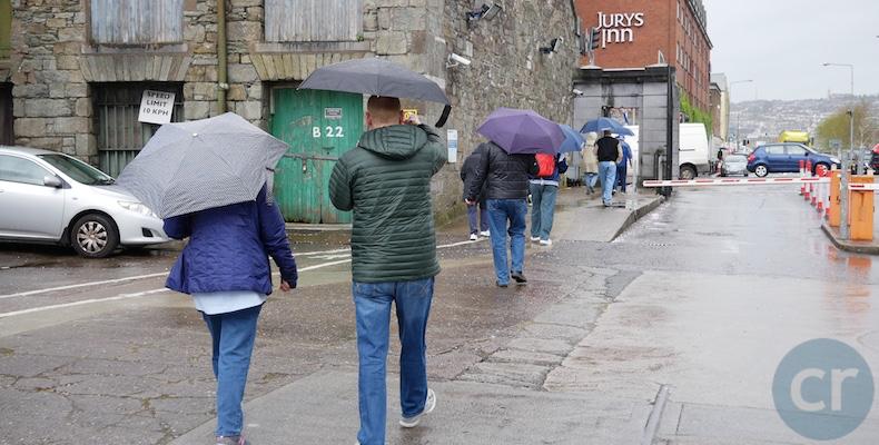 Tauck guests with umbrellas in Cork Ireland.png