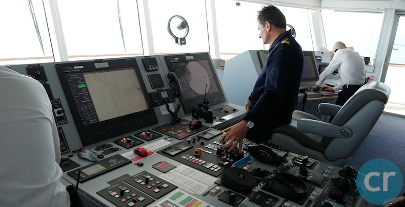 The Captain heads the ship towards Guernsey from the bridge