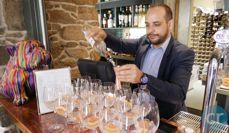 Bartender pouring gin-and-tonic at Bella Luce