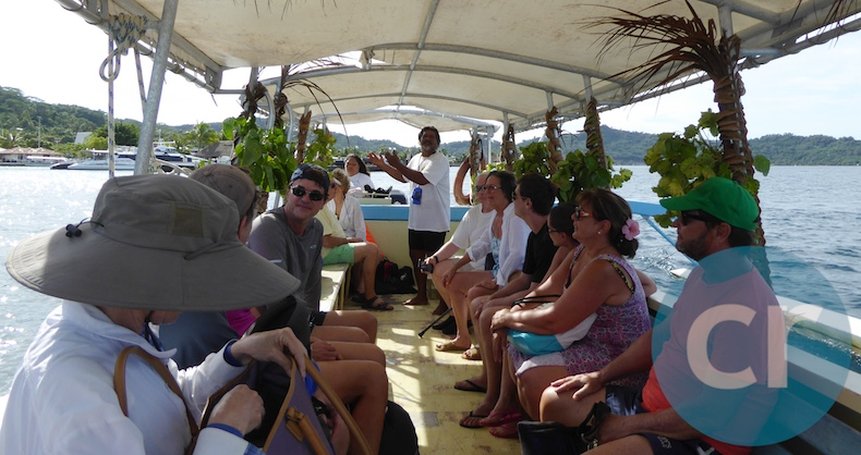 m/s Paul Gauguin guests aboard outrigger heading to Lagoonarium to snorkel in Bora Bora
