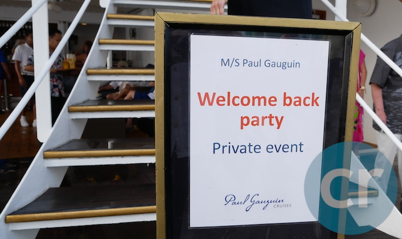 Sign on m/s Paul Gauguin identifying the repeat guest party