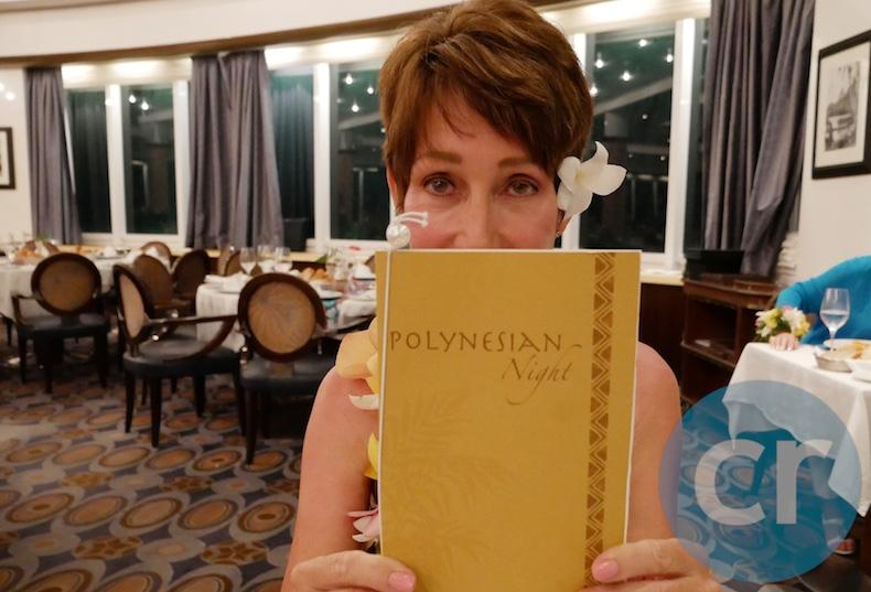 Rickee Richardson holding evening menu at L'Etoile on m/s Paul Gauguin