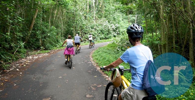 Some guests from m/s Paul Gauguin ride up a mountain in Moorea on the Slow-Paced Belvedere E-Bike tour