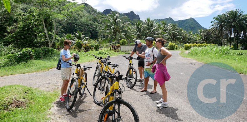 Rickee Richardson (blue tee) and others on Slow-Paced E-Bike tour in Moorea take a short break