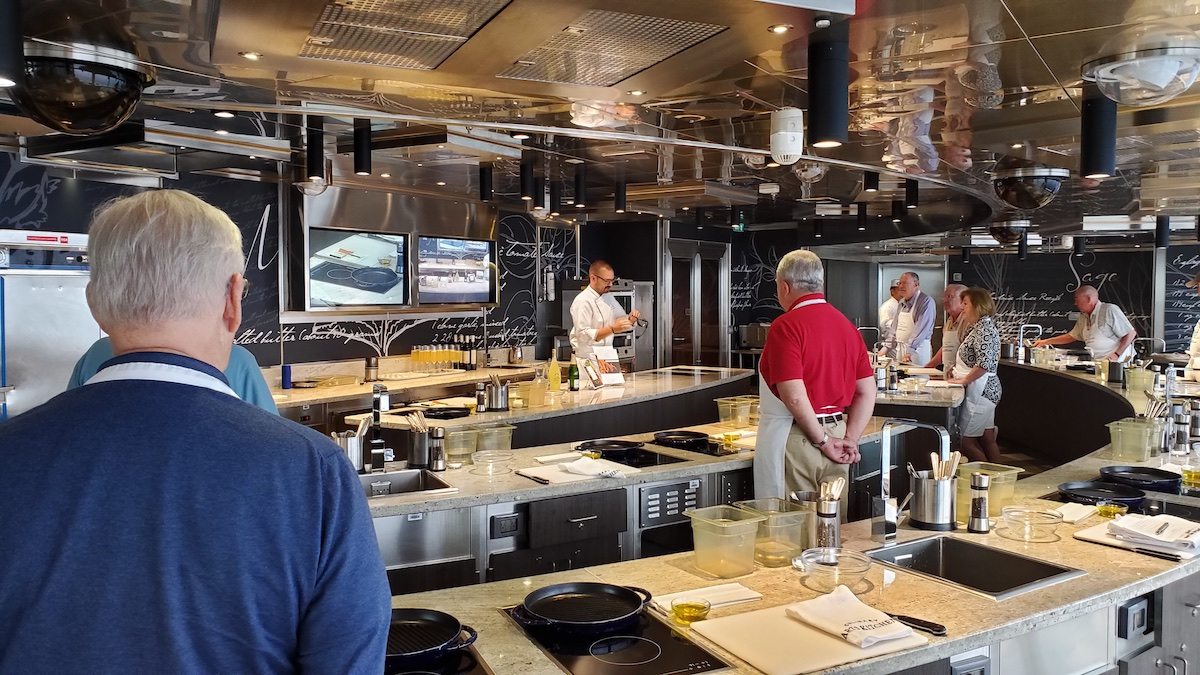 Chef Celms demonstrates techniques for the class