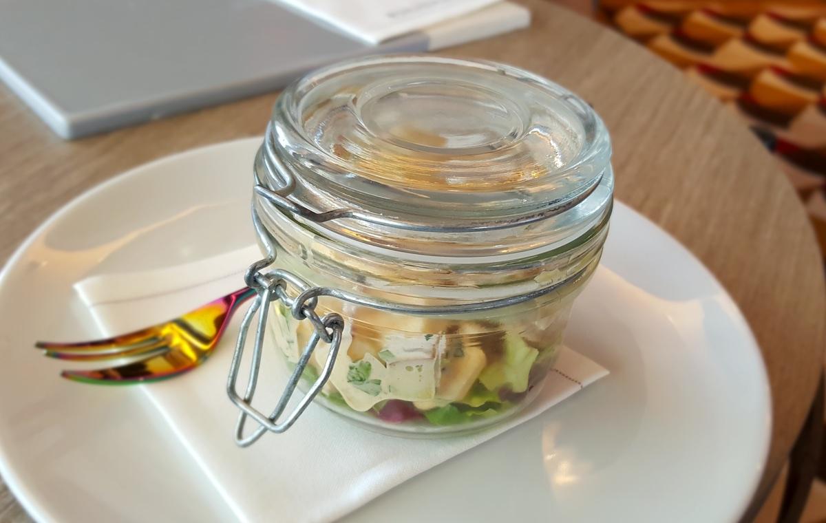 Jars contain creative salads