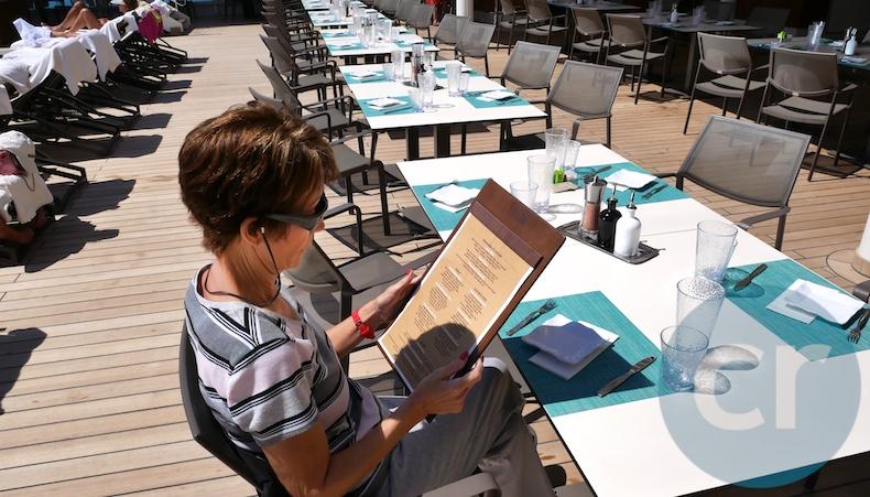 Rickee peruses the menu at Pool Grill
