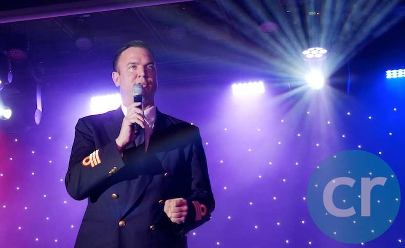 Cruise Director, Jimmy Kovel, greets guests in Venetian Lounge