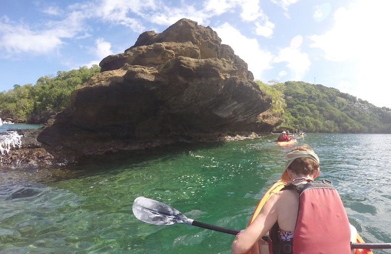 We paddle close to the shoreline