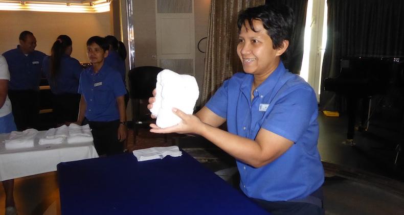 Room stewardess shows how to create a towel animal