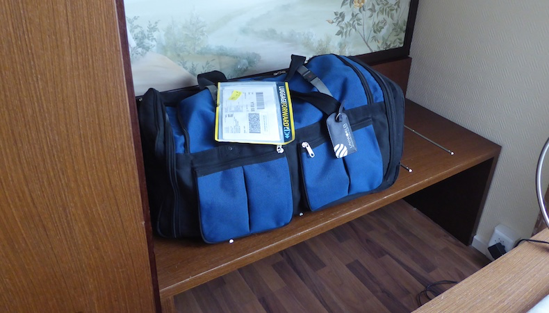My blue duffle bag shipped by Luggage Forward and waiting in hotel room
